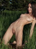 Skinny Nude Beauty Kneeling In Tall Grass - euro